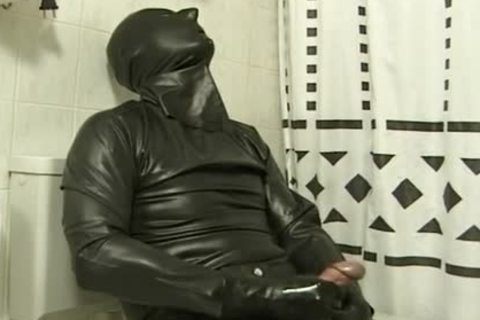 guy In dark Latex Catsuit Jacks Off In bathroom