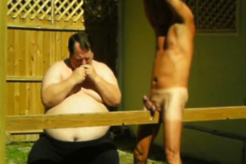 master Suspends Me Outside, Out A Plank between My Legs, Lowers Me Back Onto It, Ties My 10-Pounder To Plank And Hits It.